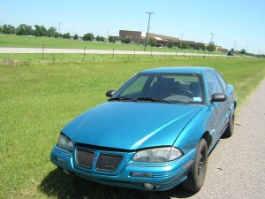 Teal Pontiac broke down on highway 2